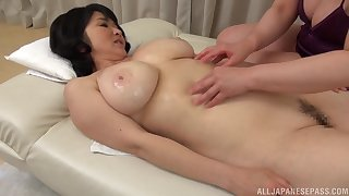 Mizuno Yoshie gives a massage to a chubby Asian chick with the addition of licks her pussy