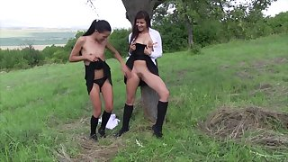 Lesbian pussy fingering in outdoors with teens Cindy and Evelyn